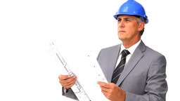 Architect looking at his construction plan Footage