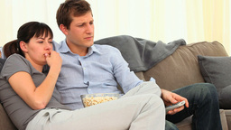 Cute Couple Watching A Scary Movie stock footage
