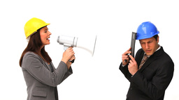 Business people with safety helmets and megaphone Footage