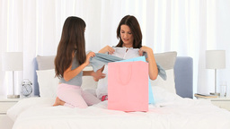 Mother and daughter unpacking shopping bags togeth Footage