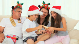 Family during Christmas with crackers Stock Video Footage