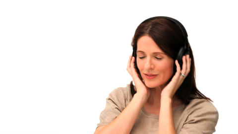 Cute middle aged lady listening to music Stock Video Footage