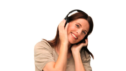 Cute middle aged lady listening to music Footage