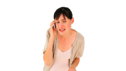 Brunette girl getting nervous on the phone Stock Video Footage