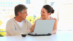 Couple talking in front a laptop Footage