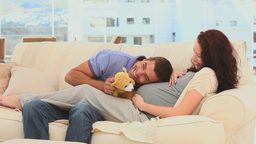 Lovely couple playing with a teddy bear Footage