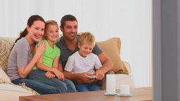 Smiling family watching a movie Stock Video Footage
