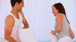 Happy couple playing with pillows Stock Video Footage