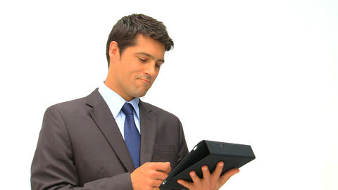 Businessman checking his touch pad against a white Footage