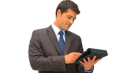 Businessman working on his graphic tablet against Stock Video Footage
