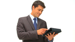 Businessman working on his graphic tablet against  Footage