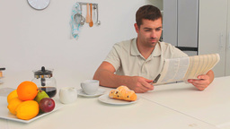 Man having breakfast in the kitchen Stock Video Footage