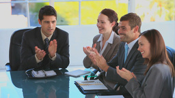 Business team clapping their hands during a meetin Stock Video Footage