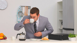 Businessman drinking his coffee before go to his w Footage