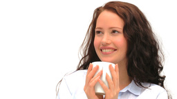 Woman drinking a cup of coffee against a white background Stock Video Footage