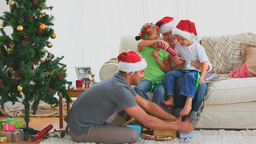 Happy family on Christmas day Stock Video Footage