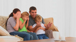 Family watching a scary movie Stock Video Footage
