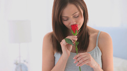Woman smelling her rose Footage