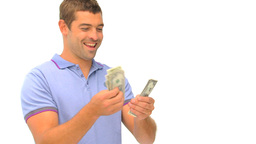 Man counting and kissing his money Stock Video Footage
