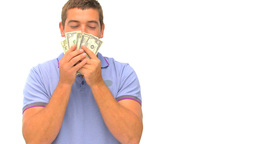 Man counting and kissing his money Footage