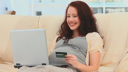 Pregnant woman buying something on the net Stock Video Footage