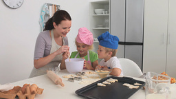 Mother baking with her children Stock Video Footage