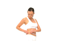 Woman measuring her waist against a white backgrou Stock Video Footage