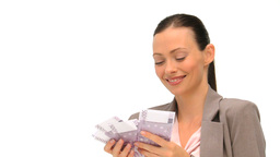 Joyful businesswoman counting her money against a  Footage