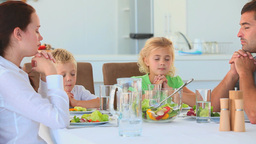 Family praying at the table Stock Video Footage