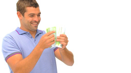 Happy man counting his money against a white backg Footage