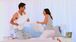 Couple having a pillow fight Footage