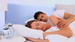 Man waking up her girlfriend Stock Video Footage