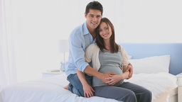 Man embracing his pregnant wife Stock Video Footage