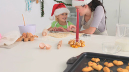 Mother and daughter cooking together Stock Video Footage