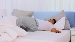 Extremly tired man sleeping fitfully Stock Video Footage