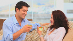 Handsome couple drinking a glass of white wine Footage