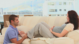 Male massaging feets of his pregnant wife Stock Video Footage
