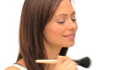 Wonderful brunette putting on makeup Footage