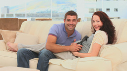 Couple letting his future baby listening to music Footage
