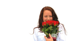 Brunette lady holding a bunch of flowers Footage