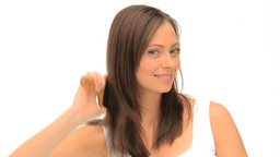 Woman fixing her hair Footage