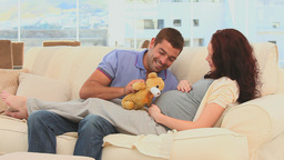 Lovely Couple Playing With A Teddy Bear stock footage