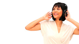 Attractive asian woman listening to music Stock Video Footage