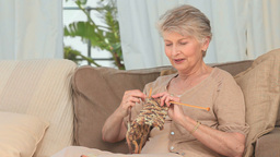 Retired woman knitting Footage