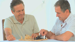 Retired friends playing chess Footage