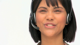 Asian business woman speaking into a headset Footage