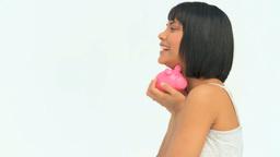 Attractive asian woman saving money Footage