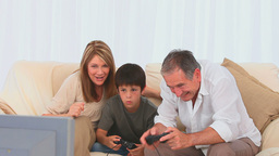 Grandparents playing video games with their grands Footage