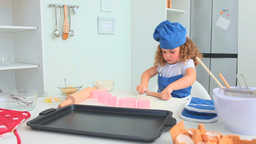 Cute child baking a cake Footage