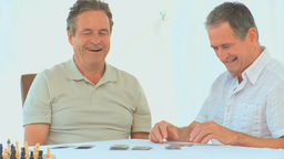 Friendly retired man playing cards Footage